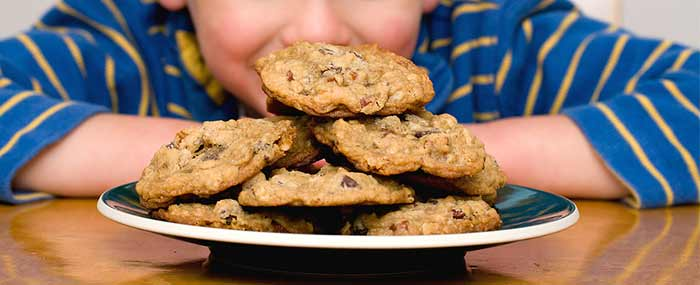 kid with cookies