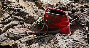 red shoe stuck in mud