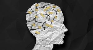 crumpled paper taped to show traumatized brain