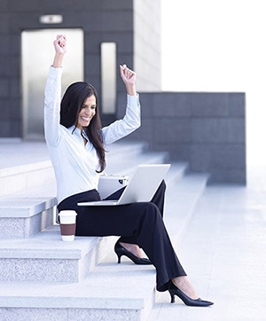 Successful Woman Sitting on Steps with Laptop