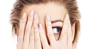 Woman hiding eyes