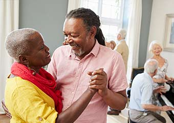 happy elderly couple dancing