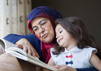 muslim grandmother reading