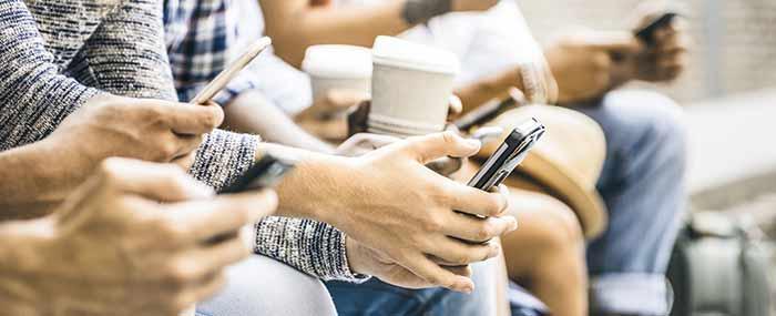teen students on phones